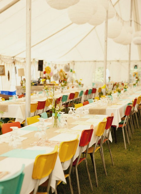 The bride chose the bright colors of the chairs of her community hall