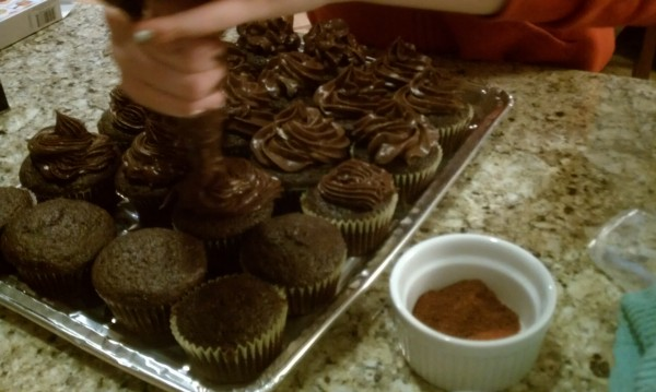 Chocolate cupcakes with chili chocolate frosting.