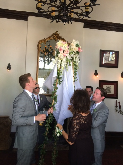 chuppah holders lead wedding procession