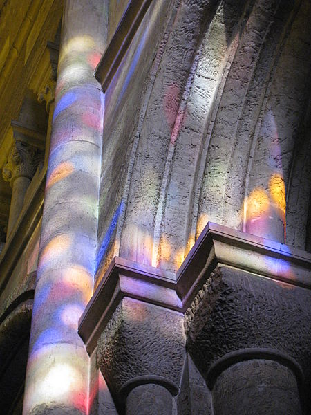 Colored light falls on the columned walls of an ancient building